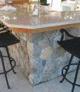 weathered-round-outdoor-kitchen