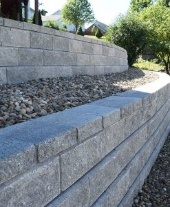 allan block retaining wall classic grey with beach pebbles
