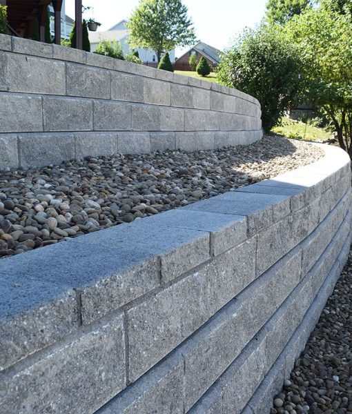 allan block retaining wall classic grey with beach pebbles