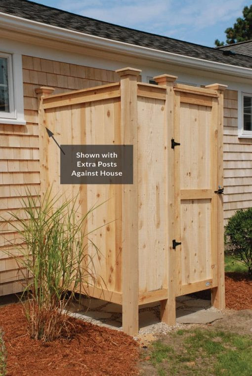 outdoor shower kit with extra cedar posts against house