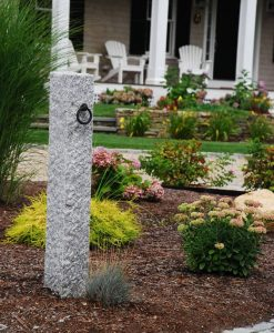 granite hitching post in garden