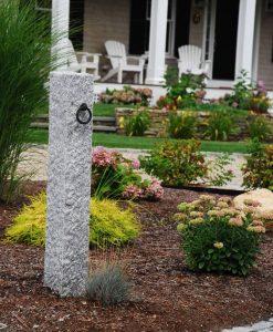 granite hitching post in garden