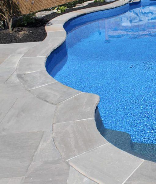 stone pavers around pool