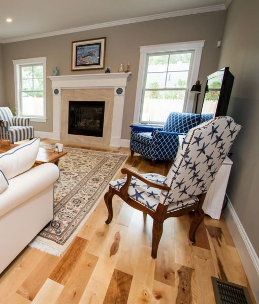 Prefinished Cottage Birch by Wickham, installed in living room with fireplace