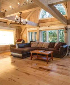 Wickham Prefinished Cottage Maple installed in living room with sectional couch