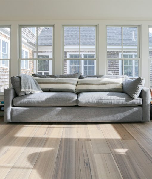 grey wide wood plank flooring sunroom