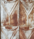antique-tin-ceiling-tiles-reclaimed-wallboarding-closeup