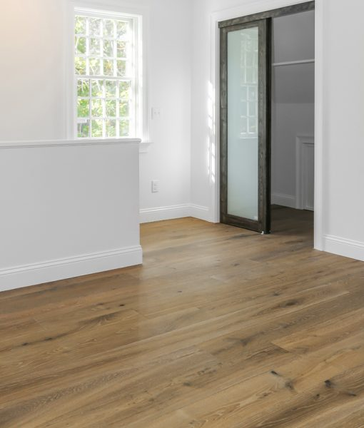 Structured Wide Plank Floors - Miacomet installed on bottom floor near entryway