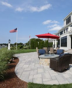 Waterfront Patio featuring Techo Bloc Blu60 Slate Grey Pavers, Ebel Furniture and Custom Fire Pit