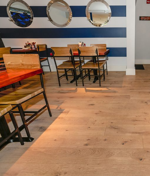 Nautical Design - Sawyer Mason Oak Bluffs Wide Plank Flooring installed at Mac's Seafood Chatham Fish & Lobster