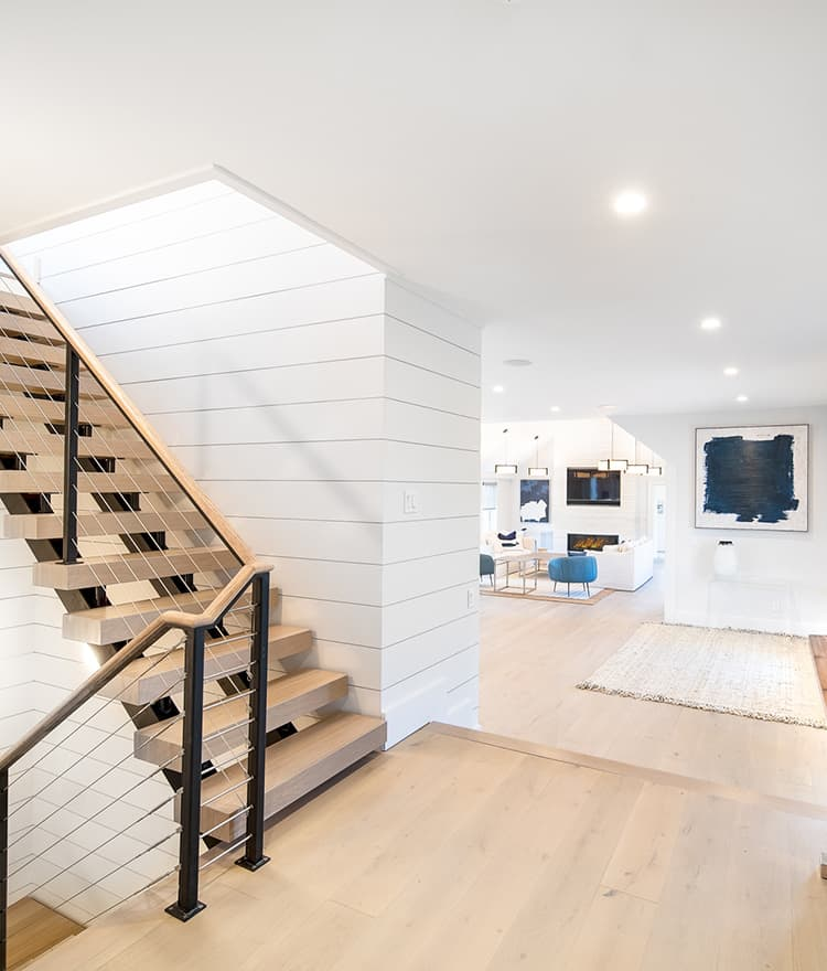 Sawyer Mason Structured Fogg Wide Plank Floors with matching stair treads and shiplap walls