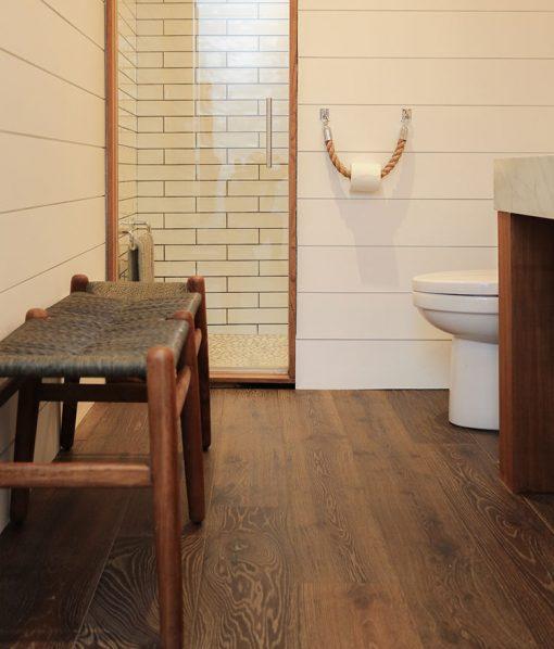 Cozy Cottage with Sawyer Mason Esplanade installed in bathroom with shiplap